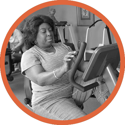 Senior woman on exercise equipment